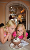 Smiling Girls Sharing Dessert stock photos