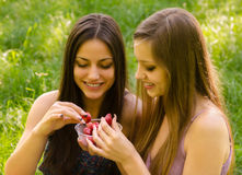 Smiling girls sharing strawberries outdoor Royalty Free Stock Photo