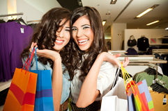 Smiling girls shopping Royalty Free Stock Images