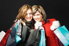 Smiling Girls with Shopping Bags Royalty Free Stock Images