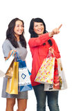 Smiling girls at shopping pointing up Stock Photography
