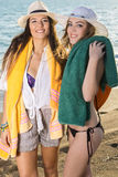 Smiling Girls with their Towels at the Beach Stock Photography