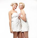 Smiling girls in towels Stock Photography