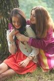 2 smiling girls Royalty Free Stock Photos