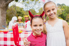 Smiling girls wearing costume during a birthday party Stock Photography