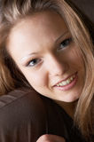 Smiling glance :-). Open glance of amused smiling beautiful girl Royalty Free Stock Photos