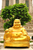 Smiling Golden Buddha Statue Royalty Free Stock Photo