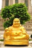 Smiling Golden Buddha Statue Royalty Free Stock Photo