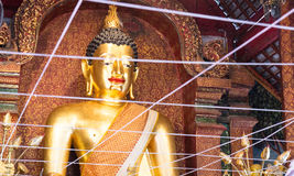 Smiling golden buddha statue. In asian temple monastery Stock Photos