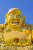 Smiling Golden Buddha Statue. Royalty Free Stock Photo