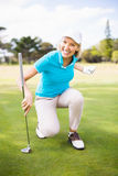 Smiling golfer woman clenching fist. Portrait of smiling golfer woman clenching fist Stock Photos