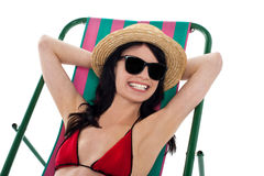 Smiling gorgeous bikini model in dark shades Royalty Free Stock Images