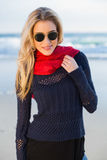 Smiling gorgeous blonde with red scarf posing Stock Photos