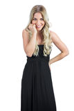 Smiling gorgeous blonde wearing black dress posing Royalty Free Stock Photos