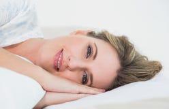 Smiling gorgeous blonde woman sleeping Stock Images