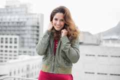 Smiling gorgeous brunette in winter fashion looking at camera Stock Photo