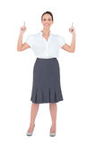 Smiling gorgeous businesswoman posing royalty free stock images