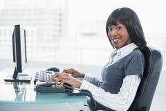 Smiling gorgeous businesswoman working Stock Photos