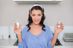 Smiling gorgeous model holding salt and pepper Royalty Free Stock Photo