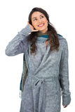 Smiling gorgeous model with winter clothes making phone call gesture royalty free stock photo