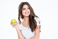 Smiling gorgeous woman holding apple and looking away Stock Photo