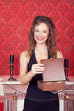 Smiling gorgeous woman opening a wooden present box Royalty Free Stock Images