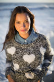 Smiling gorgeous woman with pullover posing Royalty Free Stock Photography