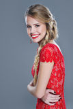 Smiling gorgeous woman in red lace dress Stock Images