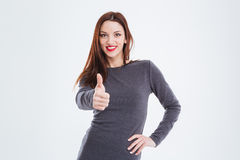 Smiling gorgeous woman with red lips showing thumbs up Royalty Free Stock Image