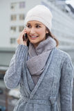 Smiling gorgeous woman wearing winter clothes having a call Royalty Free Stock Image