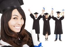 Smiling  graduate girl and  students Royalty Free Stock Photos