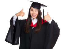 Smiling graduate girl thumb up Royalty Free Stock Photo
