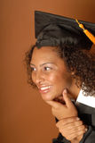 Smiling graduate looking toward copy space stock photography