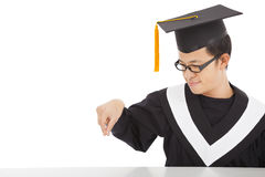 Smiling  graduating student concentrating  to catch something Stock Image