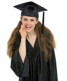 Smiling graduation student girl whispering news Stock Image