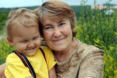 Smiling grandchild with grandmother. On a meadow Royalty Free Stock Images