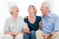 Smiling granddaughter with grandparents royalty free stock image