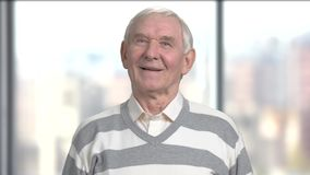 Smiling grandfather on blurred background. stock footage
