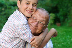 Smiling grandfather and grandson Stock Photos