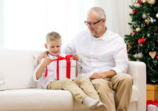 Smiling grandfather and grandson with gift box Royalty Free Stock Images