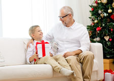 Smiling grandfather and grandson at home Stock Image