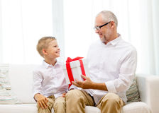 Smiling grandfather and grandson at home Royalty Free Stock Photography