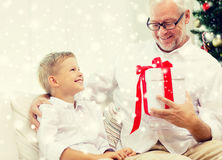 Smiling grandfather and grandson at home Royalty Free Stock Image
