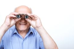 Smiling grandfather looking through binoculars Stock Photography