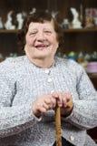 Smiling grandma with stick Royalty Free Stock Photos