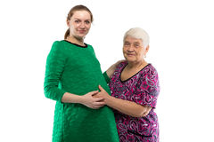 Smiling grandma touching belly of granddaughter Stock Photos