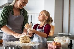 Free Smiling Grandmother And Happy Child Kneading Dough Stock Photography - 153029902