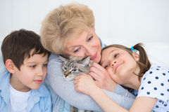 Smiling grandmother and grandchildren hugging Royalty Free Stock Photos