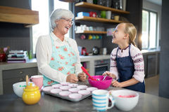 Smiling grandmother and granddaughter looking at each other royalty free stock photos