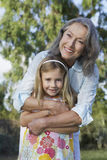 Smiling Grandmother With Granddaughter Outdoors Royalty Free Stock Photos
